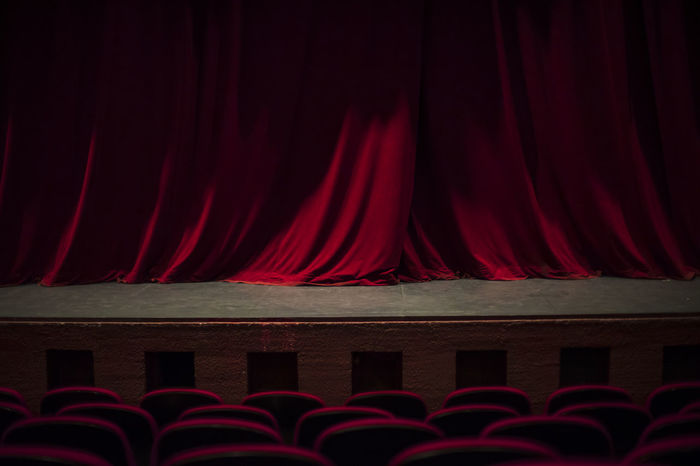 Theater seats Red Curtain Arts Culture And Entertainment Movie Theater Stage Theater Stage - Performance Space Stage MOVIE Indoors  Dark No People Velvet Film Industry Architecture Theatrical Performance Night Performance Nightlife Event