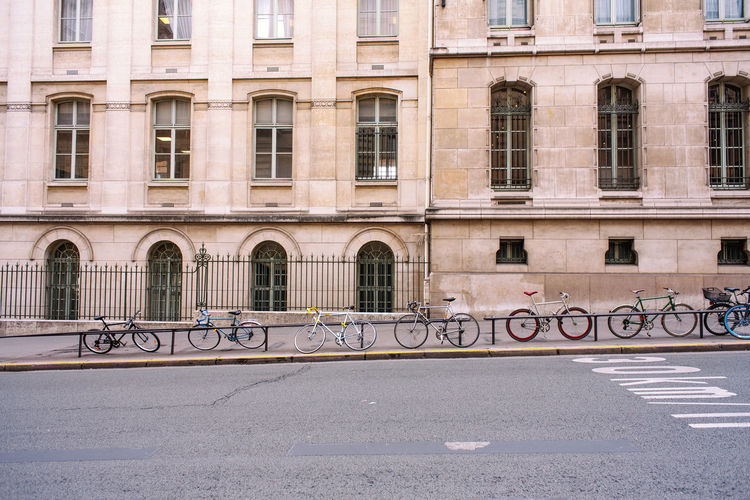 Architecture Built Structure Building Exterior Transportation Road City Street Day Window No People Road Marking Sign Marking Bicycle Building Outdoors Symbol Railing In A Row Land Vehicle Paris France