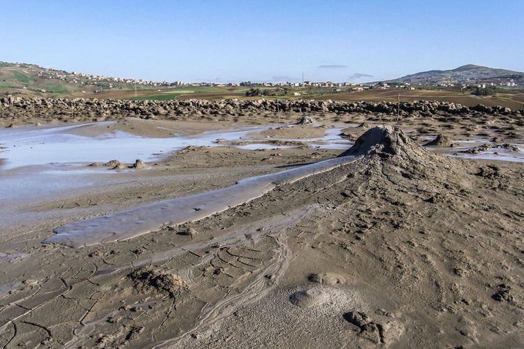 "Area with mud volcanoes, called ""Macalube"", near Agrigento Agrigento Aragona Geological Geology Italy Landscape Macalube Mud Mud Flow Mud Volcano Mud Volcanoes Nature Nature Outdoors Outside Sand Scenics Sicily Sunny Volcano Water"