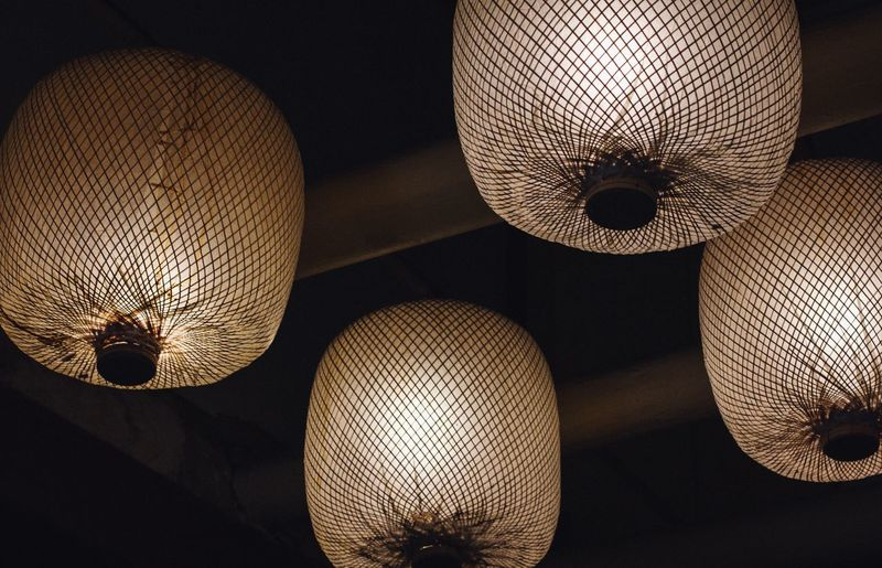Low Angle View Of Illuminated Light Fixtures Hanging From Ceiling