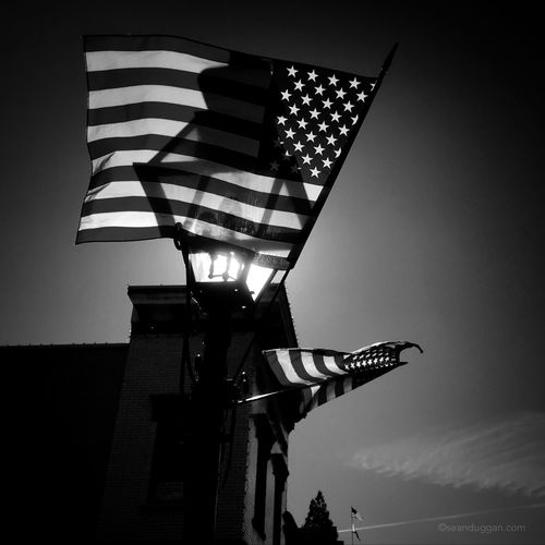 Three Flags. Happy Birthday America. Now, more that ever, I hope you can always find the light. . . . #4thofjuly #july4th #independenceday #flag #americanflag #light #lightoverdarkness #hope #blackandwhite #blackandwhitephotography #nevadacityca #nevadacity #nevadacounty #california Low Angle View Sky Flag Nature Illuminated No People Outdoors