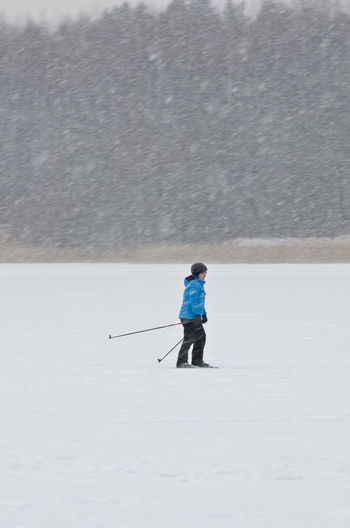Skiing and snowing Cold Temperature Escapism Finland Getting Away From It All Hobbies Järvenpää Leisure Activity Lifestyles Men Outdoors Real People Skiing Snow Snowing Snowing ❄ Sport Sports Vacations Weather Weekend Activities Winter Winter
