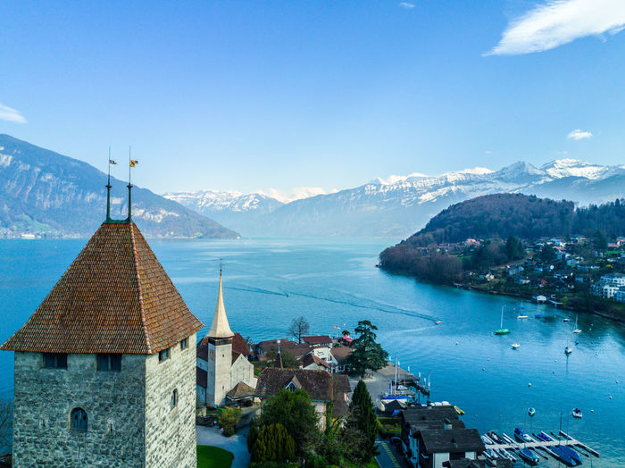 Architecture Beauty In Nature Blue Building Exterior Built Structure Castle Day House Mountain Mountain Range Nature No People Outdoors Scenics Sea Sky Spiez Switzerland Tree Water