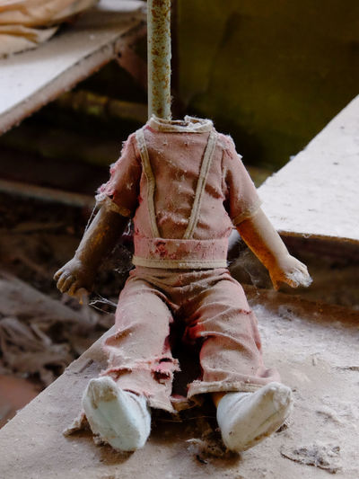 Close-up of toy sitting on wood