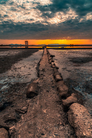 Path Sunset Silhouettes Sunset_collection Beach Beauty In Nature Cloud - Sky Diminishing Perspective Direction Dirt Environment Land Mud Nature No People Orange Color Outdoors Reflections Scenics - Nature Sky Sunset Surface Level The Way Forward Tranquil Scene Tranquility Water
