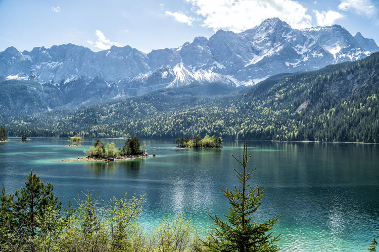 Eibsee with Zugspitze in the background Beauty In Nature Mountain Scenics - Nature Water Tranquil Scene Lake Tranquility Tree Plant Non-urban Scene Mountain Range Sky Idyllic Nature Day Reflection No People Cold Temperature Outdoors Snowcapped Mountain Mountain Peak Turquoise Colored Mountain Lake Alps Bavaria
