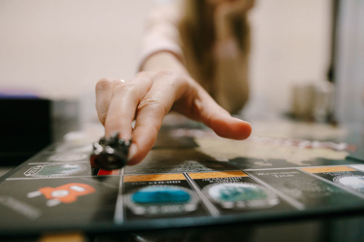 Close-up of woman hand playing board game