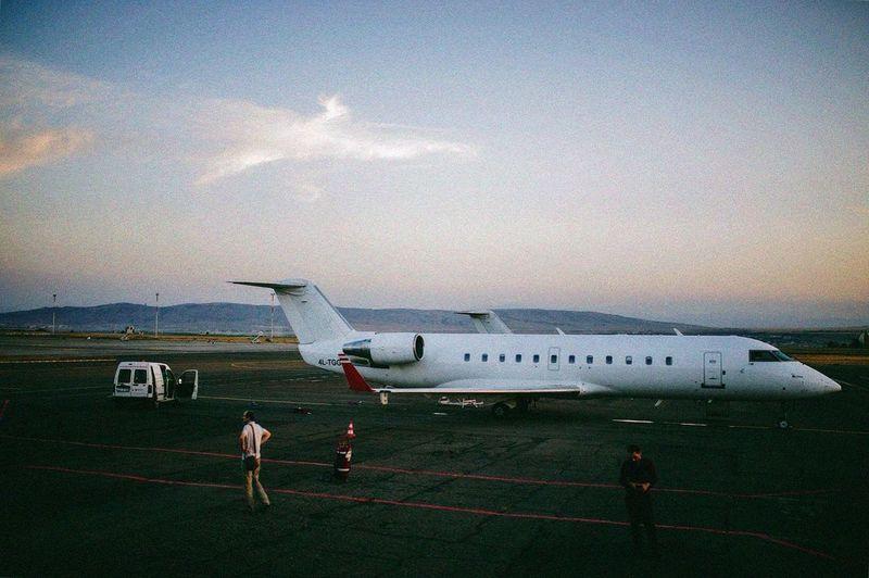 Airplane Airport Runway Airport Sky Air Vehicle Outdoors People Aerospace Industry Day