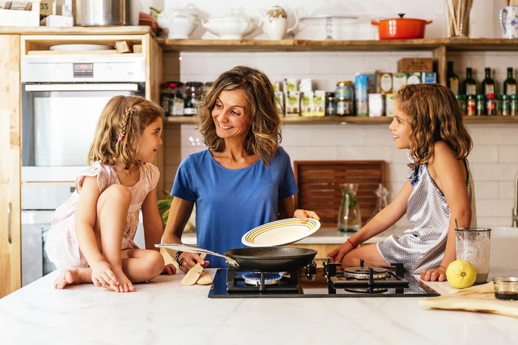 Mother Childhood Children Girls Cooking Kitchen Daughter Sister Mom Family Happy Fun Love Food Healthy Preparation  Woman Sweet Blonde Caucasian Having Fun Copy Space People Baking Making