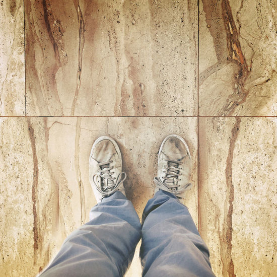 Circle Concrete Day Dirty Dirty Shoes Footpath Ground High Angle View Human Foot Legs Low Section Man Legs Man Shoes Marble Men Person Personal Perspective S Shoe Shoes Standing View From Above View From The Top