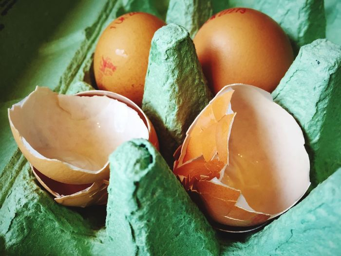 Eggs and eggshells in an egg box. Delicate Broken Egg Box Food And Drink Food Egg Freshness Close-up Healthy Eating Still Life Fragility Vulnerability  Eggshell Raw Food Egg Carton Green Color