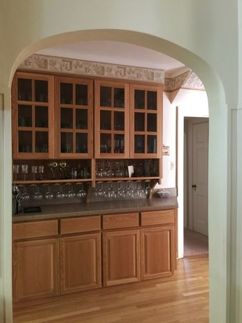 Interior Views View of the butler's pantry Arched Doorway Pantry Wine Glasses