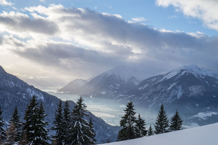 View over the Inntal Autobahn Valley Fog Haze Alpbachtal Reith Im Alpbachtal Austria Inntalautobahn Winter Winterlight Snow Winter Cold Temperature Pine Tree Pinaceae Mountain Tree Forest Landscape Beauty In Nature Outdoors Travel Destinations Scenics No People Shades Of Winter