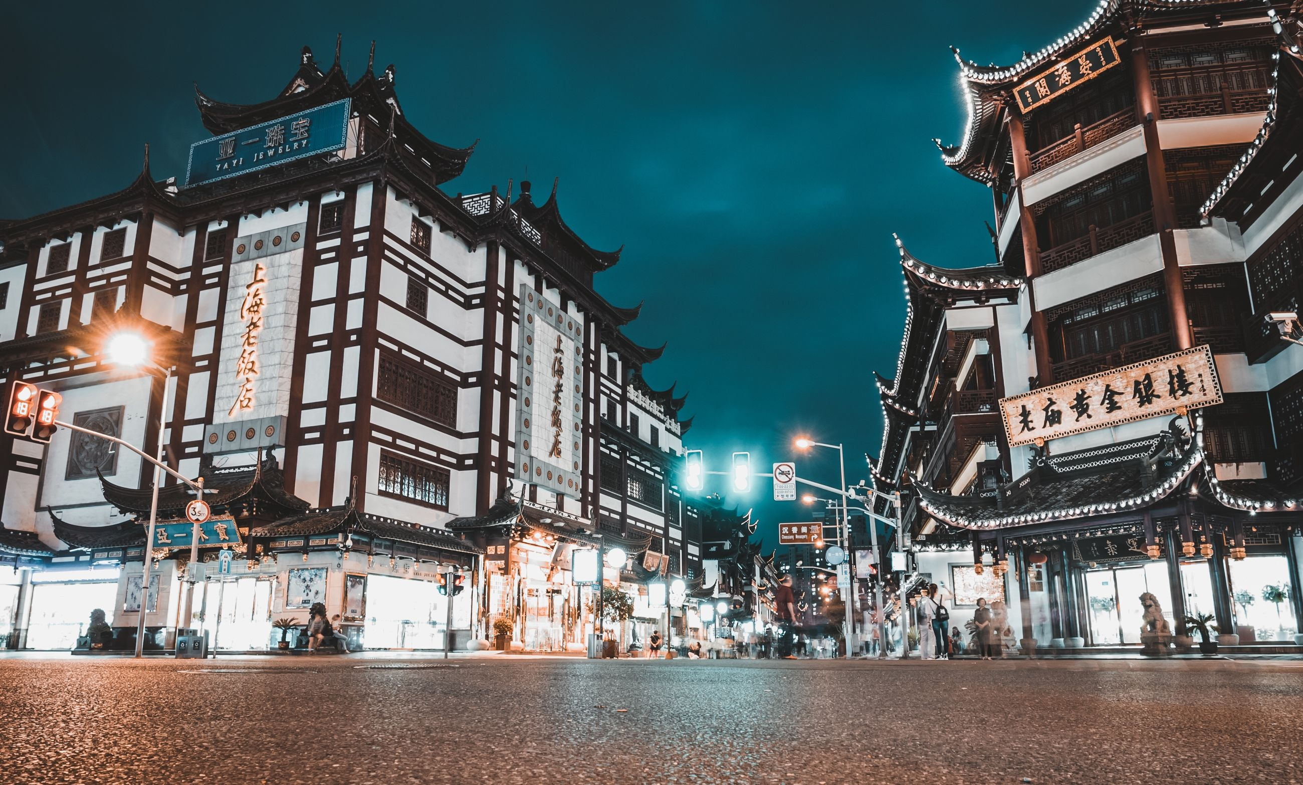 building exterior, architecture, built structure, illuminated, night, city, building, sky, street, incidental people, lighting equipment, nature, residential district, dusk, street light, travel destinations, outdoors, glowing, window, light, nightlife