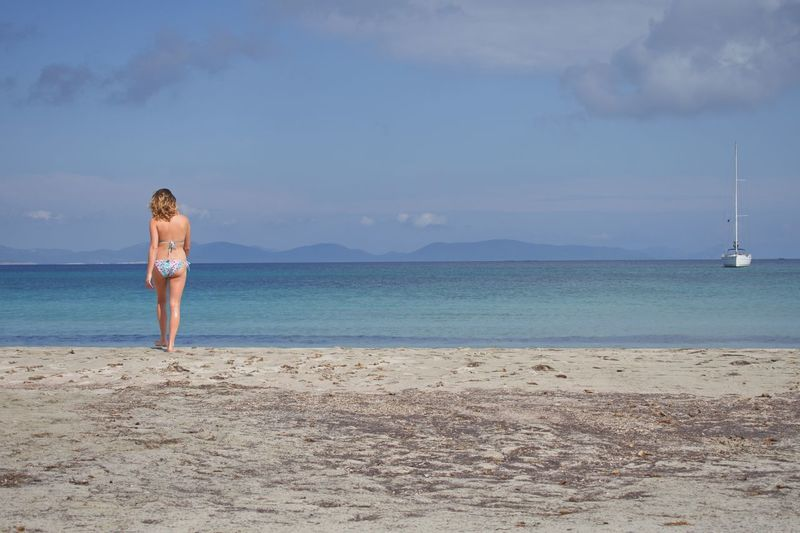 Sea Water Beach Sky Land One Person Beauty In Nature Leisure Activity Scenics - Nature Nature Real People Standing Women Full Length Day Lifestyles Horizon Over Water Vacations Trip Sand