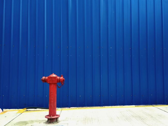 EyeEm Selects Outdoors No People Blue Day Accidents And Disasters Fire Hydrant Red Corrugated Iron Sky Nature City