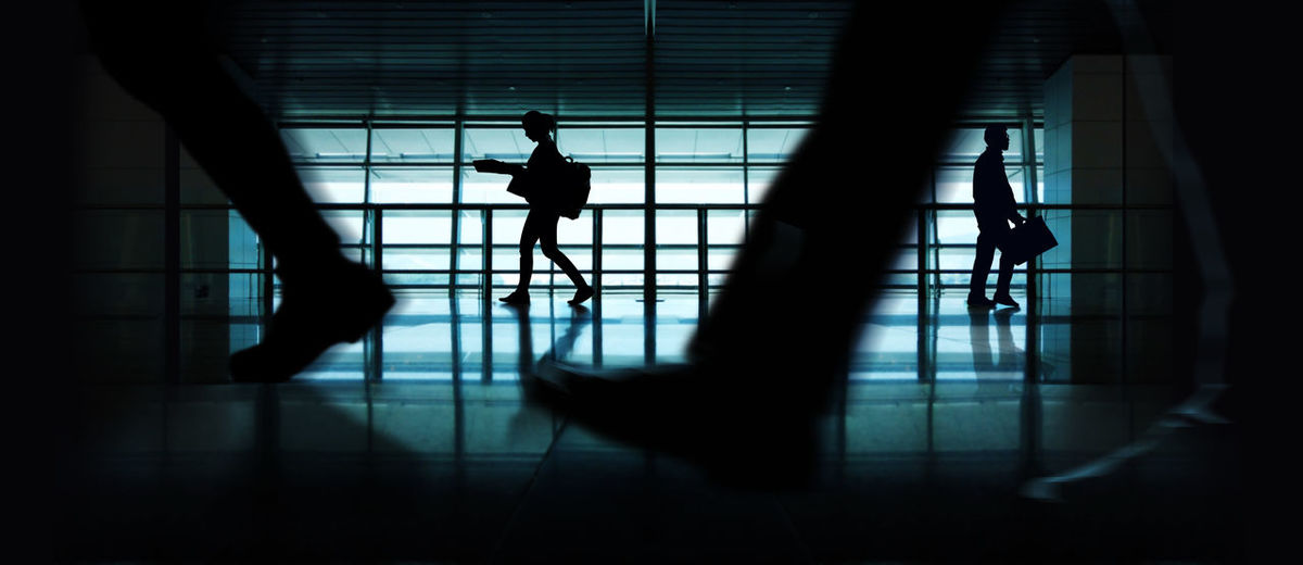 Silhouette of Walking People. Indoor Urban Scene. Side view People Walking Silhouette City person Urban Businessman Woman Female Life Routine Group Crowd Office Business Blurred Motion Salaryman Job Male Female Reading Newspaper Suitcase Traveler Map Backpacker Metropolis Building Indoor Scene Side View Professional Background Men Worker Hour Commuter Travel Journey Working Employees Cityscape Street Legs Speed Rush Modern