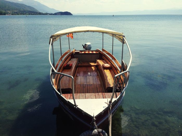 Empty boat moored at lake ohrid