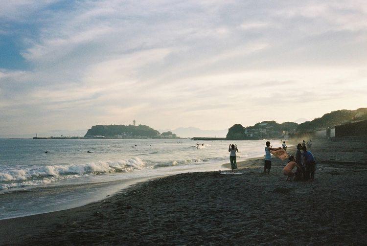 Showcase July Travel Photography Kamakura Enoshima Japan Ultimate Japan Beachphotography Relaxing People Watching Filmisnotdead Film Photography 35mm Film Film Contax T3 Enjoying Life