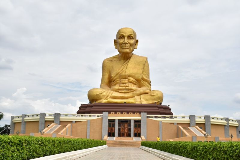 Golden Statue Of Luang Pu Thuat Against Sky