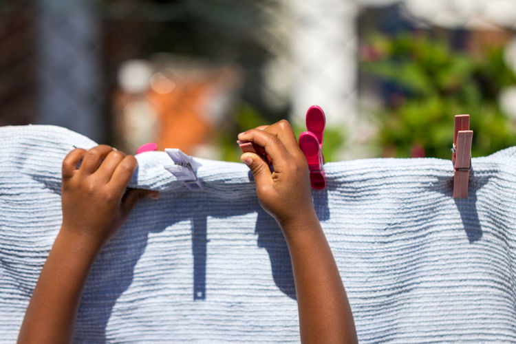 African African American Clothes Pegs Afro Caribbean Black British Close-up Clothes Peg Focus On Foreground Garden Human Body Part Human Hand Laundry Pegs Lifestyles Outdoors Peg Pegs People Person Of Color Person Of Colour Playing Real People Washing Line Kid Young Person Child