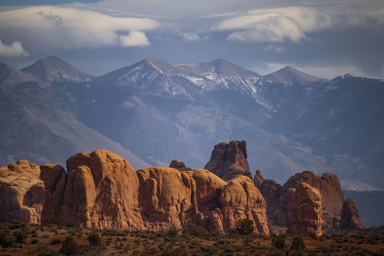 Canyon with snowy mountains on back in utah arches national park