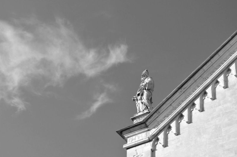 Low Angle View Of Statue On Historic Building Against Sky
