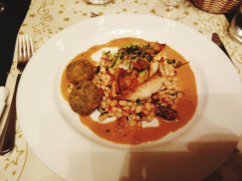 Traditional Czech Christmas Eve dinner: perch with bean cassoulet. Food Fine Dining Fish Perch Beans