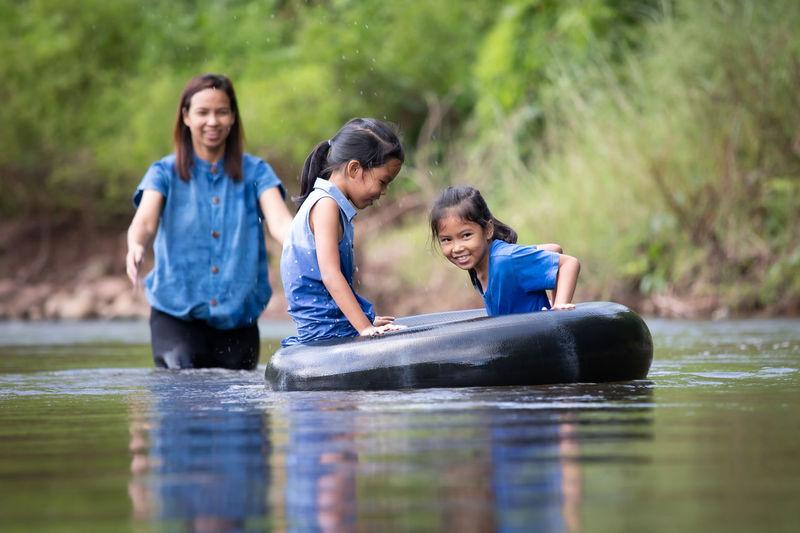 Portrait of siblings on water