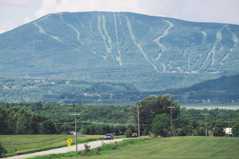 Scenic drive to Quebec. Quebec Beauty In Nature Canada Countryside Day Grass Green Color Landscape Mountain Mountain Range Nature No People Outdoors Scenic Drive Scenic View Scenics Sky Tranquility Tree