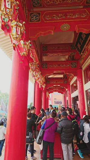 It's already the nineth day of Lunar New Year, but crowds still gather in temples to say their new year prayers. Temple Red Architecture Travel Destinations Built Structure Cultures Tradition Day Chinese New Year Hong Kong Chinese