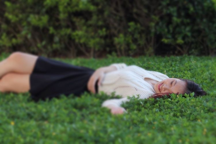 Beautiful Woman Relaxing Moments Smiling Face In Love With This Girl ❤ Grassy Happy Girl  Happy Moments This Is My Skin Lying Down Grass Selective Focus Plant Relaxation Leisure Activity Lying On Back Women Outdoors Land Adult Day One Person Sleeping