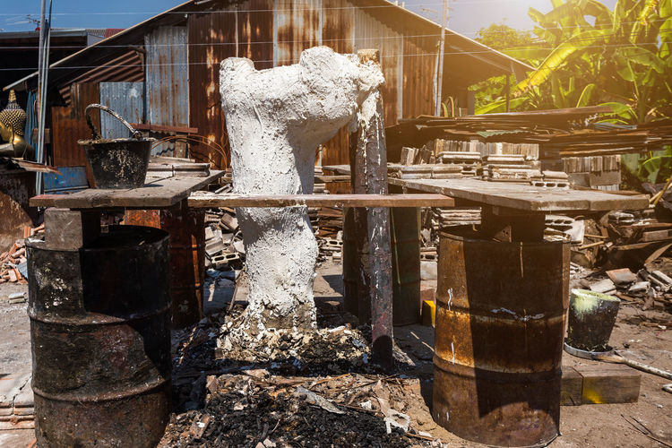 Buddha Temple Buddha Temple, Thailand Molten Metal Is Poured Into A Sand Mold Aluminum Casting And The Buddha Temple Architecture Belief Building Building Exterior Built Structure Day Fountain Nature No People Outdoors Place Of Worship Plant Religion Representation Solid Spirituality Sunlight Water Wood - Material