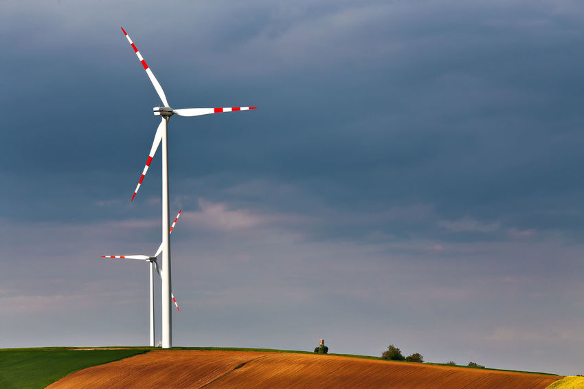 Alternative Energy Beauty In Nature Cloud - Sky Day Flag Fuel And Power Generation Industrial Windmill Low Angle View Nature No People Outdoors Renewable Energy Sky Spring Technology Traditional Windmill Wind Power Wind Turbine Windmill