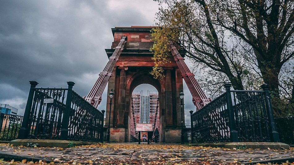 South Portland Street Suspension Bridge GLASGOW CITY Glasgow Streets Glasgow  Suspension Bridge Bridge - Man Made Structure Architecture Built Structure Sky Cloud - Sky Arch Nature Travel Destinations Building Exterior Tree Tourism Plant History City The Past Travel No People Low Angle View Day