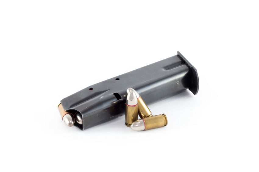 Black magazine for handguns, three cartridge cases with a silver head, Silver Bullets for werewolf hunting 9mm Ammunition Bullets Caliber Cartridge Firearm Gun Handgun Hunt Magazine Shootermag Shooting Silver  Silver Colored Studio Shot Vampire Weapon Werewolf White Background