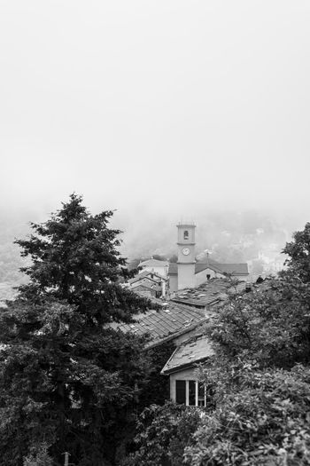A view from above over the foggy Bajardo, Imperia,Italy near Sanremo ARTsbyXD Black & White Ceriana Church Architecture Bajardo Black And White Black And White Friday Blackandwhite Building Exterior Built Structure Day Fog Foggy Foggy Landscape Italy Nature No People Outdoors Picoftheday Sky Tree
