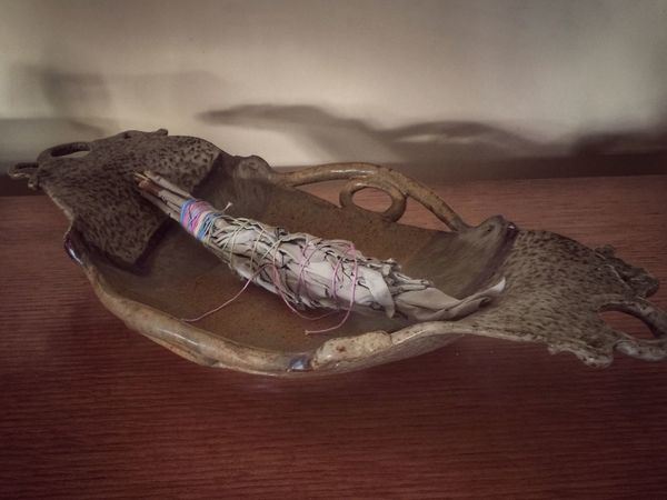 Close up of a sage smudge stick in a decorative bowl Decorative Dried Sage Smudge Stick Indoors  No People Close-up Day