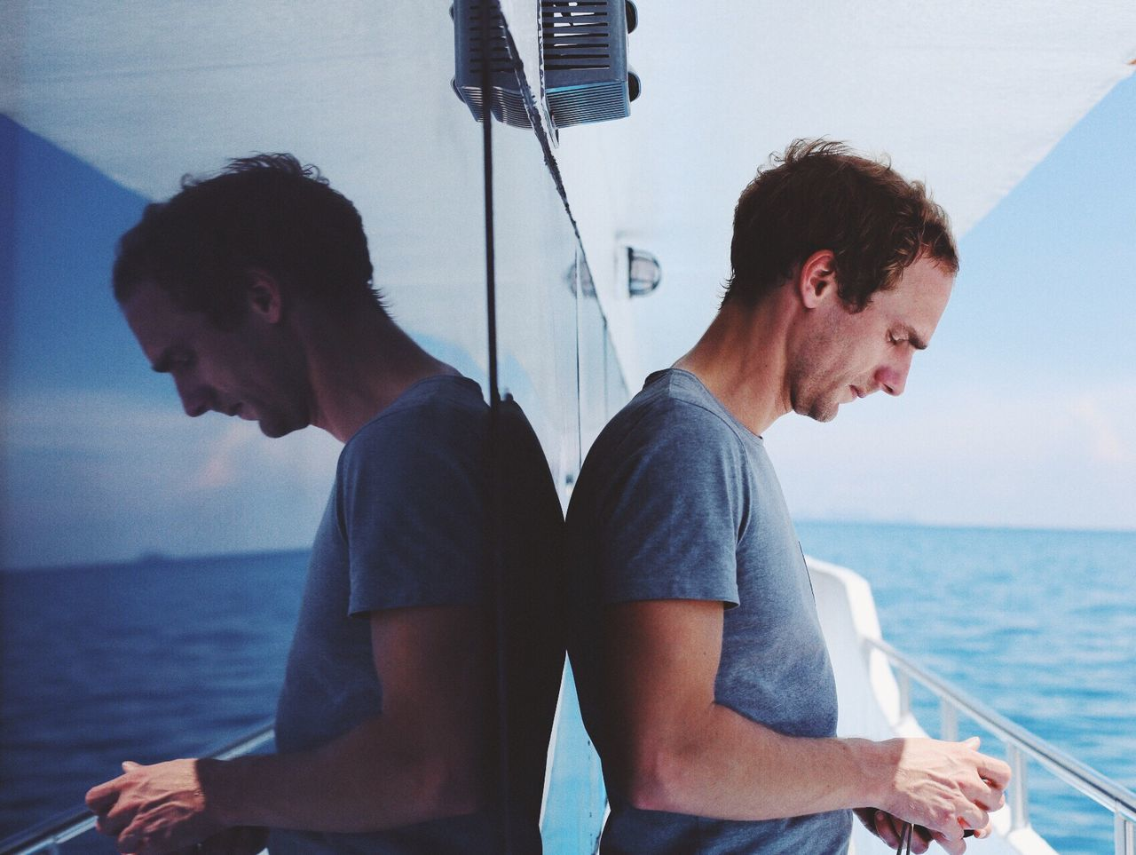 TWO MEN IN A BOAT SAILING