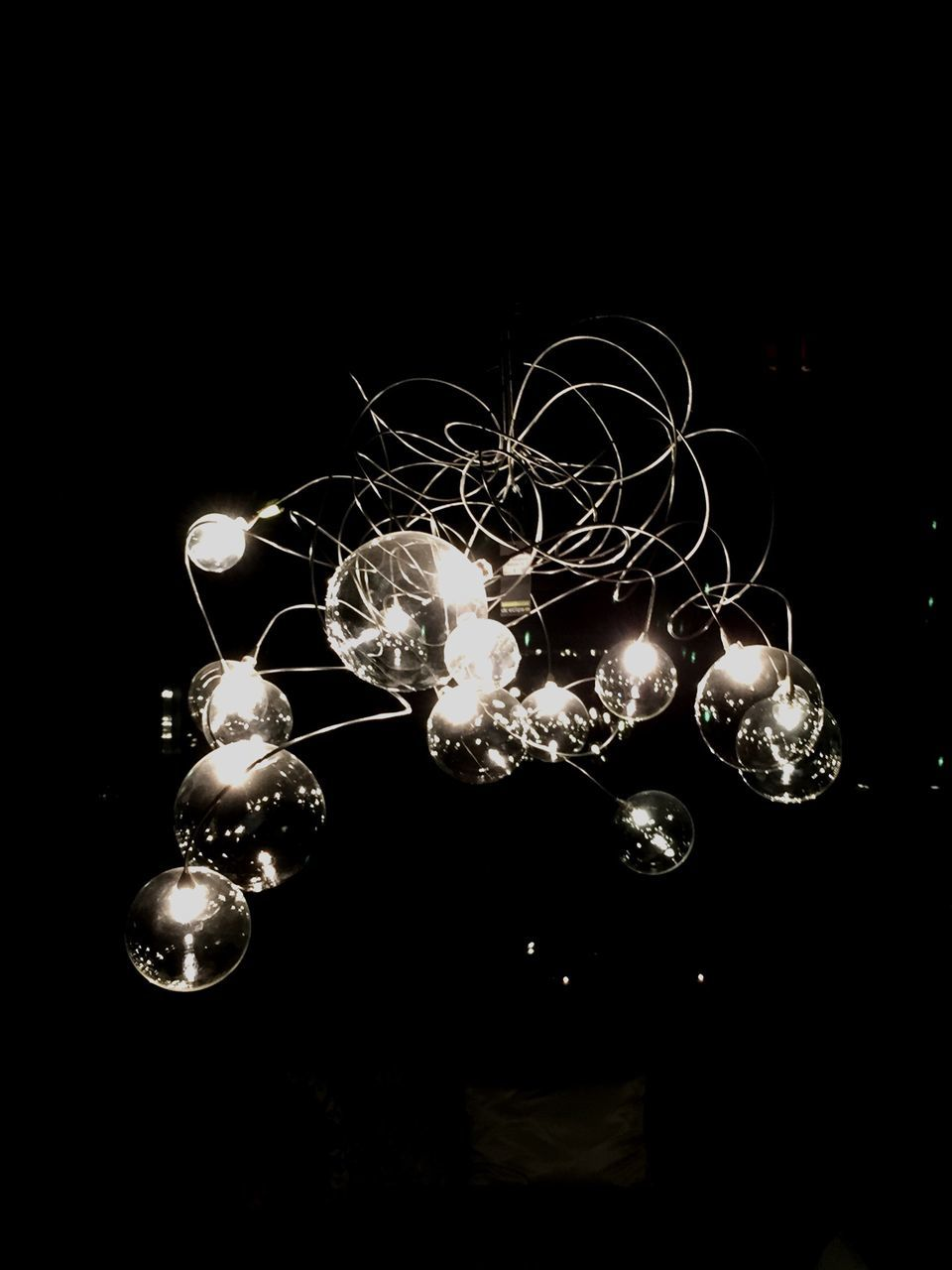 black background, lighting equipment, illuminated, studio shot, night, electricity, no people, light bulb, hanging, low angle view, close-up, indoors, filament