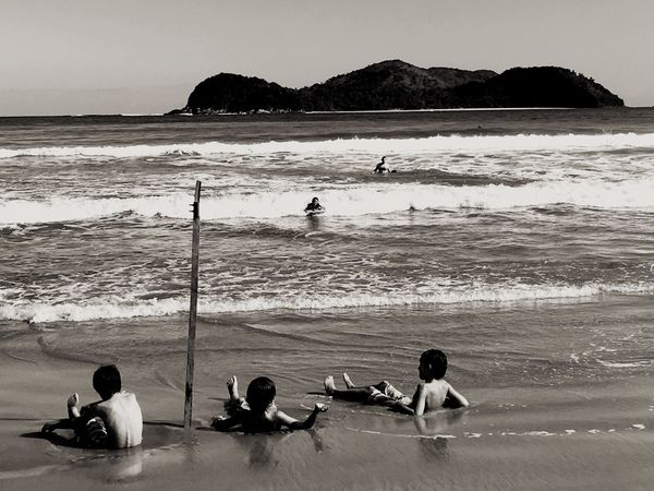 Kids playing at the beach 😆 Beach Sea Water Sand Real People Men Sitting Leisure Activity Lifestyles Nature Wave Day Scenics Beauty In Nature Horizon Over Water Outdoors Sky Kids Travel Destinations Blackandwhite Vacations Tranquil Scene Neighborhood Map People Live For The Story Live For The Story The Street Photographer - 2017 EyeEm Awards The Great Outdoors - 2017 EyeEm Awards Place Of Heart Black And White Friday The Great Outdoors - 2018 EyeEm Awards The Traveler - 2018 EyeEm Awards