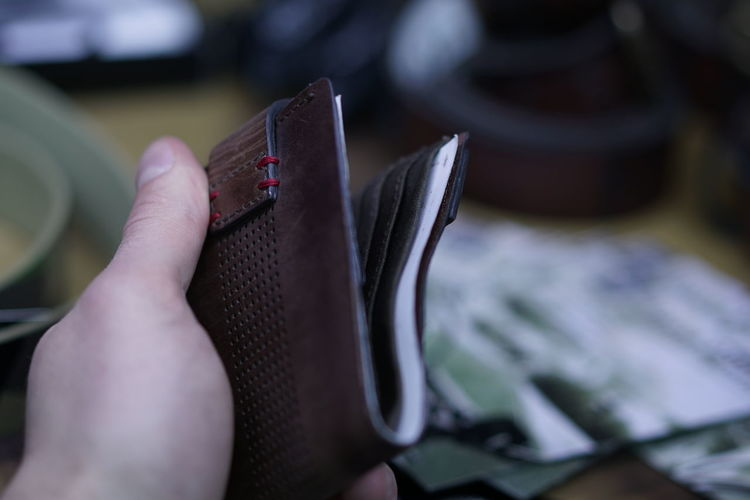 Close-up of hand holding wallet