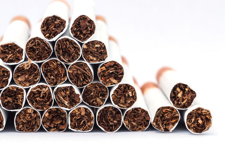 Close-up of cigarettes against white background