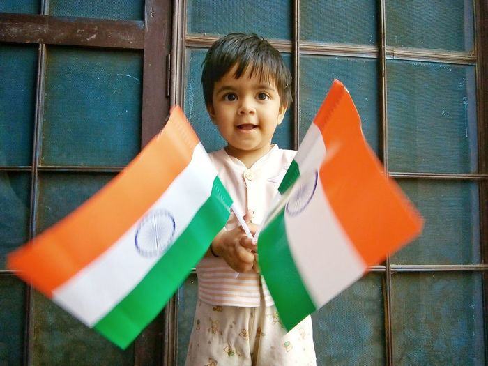 cute indian baby holding national flag of India Boy Flag Flags National National Flag Indian Flag Patriotism Patriotic Nationalism Festival Festival Goer Kid Girl Treditional Indian Indian Culture  Smiling Young Girl Colourful Portrait Child Childhood Boys Looking At Camera Playing Standing Cute Babyhood Baby Little Love Is Love
