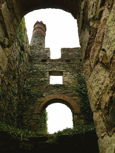 History Arch Architecture The Past Built Structure Old Ruin Day No People Low Angle View Sky Stonework. Overgrown