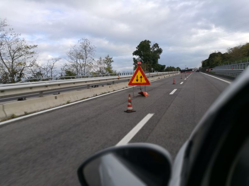 maintenance work on the motorway Asphalt Day Driving Maintenance Motion No People Outdoors Road Road Sign Speedway The Way Forward Transportation Tree Window Work In Progress