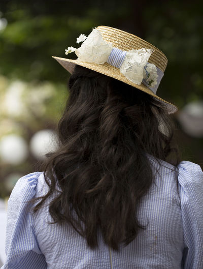 Rear view of woman wearing hat