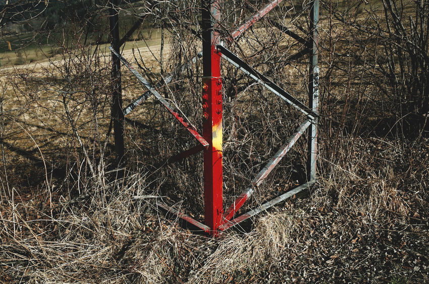 Built Structure Electricity Pylon Engineering Fields Geometric Geometric Shape Geometric Shapes Geometry Geometry In Nature Geometry Pattern Grassy Field High Visibility High Voltage Metallic Structure No People Outdoors Power Supply Power Tower Powerlines Red Rural Rural Scene Spray Spraypaint