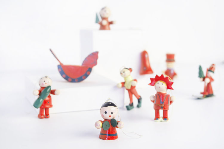 Close-up of toys on table against white background