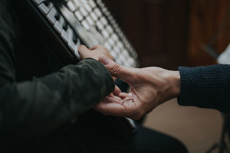 Cropped image of people playing piano